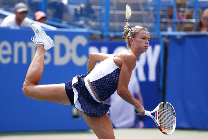 Camila Giorgi, of Italy, serves the ball to Jessica Pegula during a final match at the Citi Open tennis tournament, Sunday, Aug. 4, 2019, in Washington. (AP Photo/Patrick Semansky)