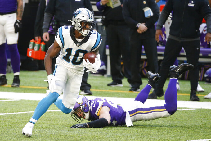 Carolina Panthers wide receiver Curtis Samuel (10) runs from Minnesota Vikings safety Harrison Smith, right, after catching a pass during the second half of an NFL football game, Sunday, Nov. 29, 2020, in Minneapolis. (AP Photo/Bruce Kluckhohn)