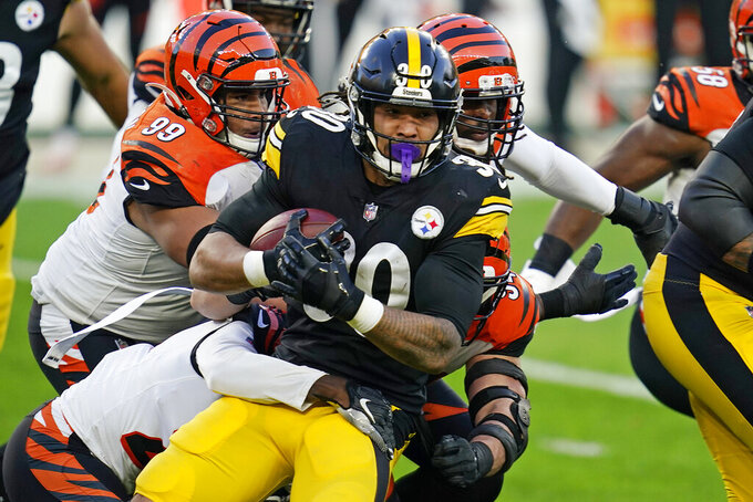 Pittsburgh Steelers running back James Conner, left, carries the ball during the first half of an NFL football game against the Cincinnati Bengals, Sunday, Nov. 15, 2020, in Pittsburgh. (AP Photo/Keith Srakocic)