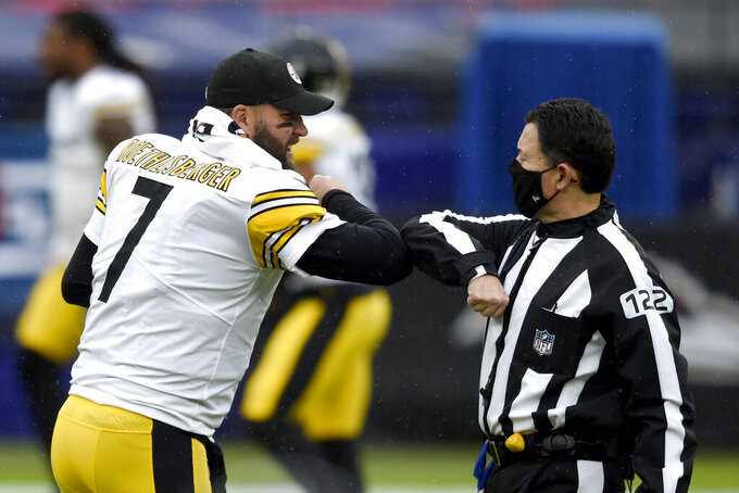 Pittsburgh Steelers quarterback Ben Roethlisberger (7) dabs elbows with referee Brad Allen (122) prior to an NFL football game against the Baltimore Ravens, Sunday, Nov. 1, 2020, in Baltimore. (AP Photo/Gail Burton)