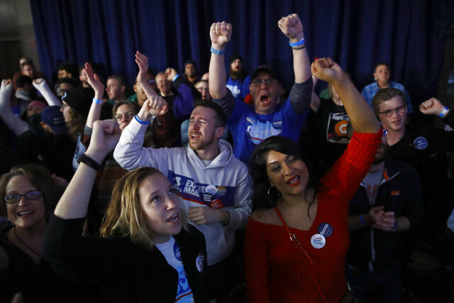 Supporters of Democratic presidential candidate Sen. Bernie Sanders, I-Vt., wait for results at a caucus night campaign rally in Des Moines, Iowa, Monday, Feb. 3, 2020. (AP Photo/Matt Rourke)
