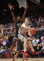Stanford guard Isaac White, right, passes the ball in front of Washington State forward Robert Franks during the first half of an NCAA college basketball game in Stanford, Calif., Thursday, Feb. 28, 2019. (AP Photo/Jeff Chiu)