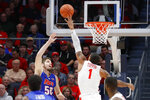 Dayton's  Obi Toppin (1) blocks a shot by Houston Baptist's Ryan Gomes (50) during the first half of an NCAA college basketball game, Tuesday, Dec. 3, 2019, in Dayton, Ohio. (AP Photo/John Minchillo)