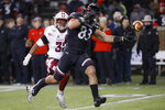 Cincinnati tight end Josiah Deguara (83) misses a pass against Temple safety Benny Walls (32) during the first half of an NCAA college football game, Saturday, Nov. 23, 2019, in Cincinnati. (AP Photo/John Minchillo)