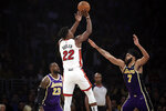 Miami Heat's Jimmy Butler (22) shoots over Los Angeles Lakers' JaVale McGee (7) and LeBron James (23) during the first half of an NBA basketball game Friday, Nov. 8, 2019, in Los Angeles. (AP Photo/Marcio Jose Sanchez)