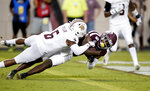 Texas A&M wide receiver Quartney Davis (1) dives over the goal line for a touchdown as Texas State cornerback Anthony J. Taylor (6) defends during the first half of an NCAA college football game, Thursday, Aug. 29, 2019, in College Station, Texas. (AP Photo/Sam Craft)