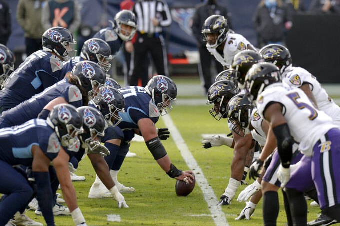 Tennessee Titans center Ben Jones (60) prepares to snap the ball against the Baltimore Ravens in the second half of an NFL wild-card playoff football game Sunday, Jan. 10, 2021, in Nashville, Tenn. (AP Photo/Mark Zaleski)