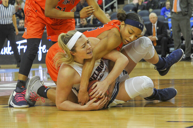 Belmont's Maddie Wright (55) fight to keep control of the floor ball as UT Martin's Brittni Moore (15) tries to get it away from her during the first half of an NCAA college basketball game in the championship of the Ohio Valley Conference basketball tournament, Saturday, March 9, 2019, in Evansville, Ind. (AP Photo/Daniel R. Patmore)