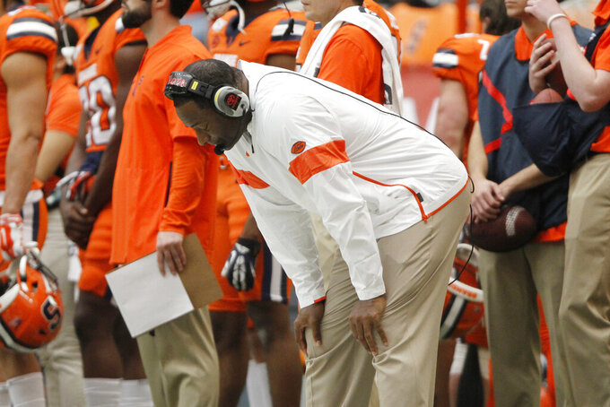 Syracuse head coach Dino Babers reacts on the sidelines in the fourth quarter of an NCAA college football game against Boston College in Syracuse, N.Y., Saturday, Nov. 2, 2019. Boston College won 58-27. (AP Photo/Nick Lisi)