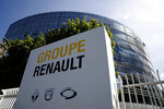 The headquarters of French carmaker Renault is pictured in Boulogne-Billancourt, outside Paris, Monday, May 25, 2020. French President Emmanuel Macron is set to unveil sweeping new measures to rescue France's car industry, hammered by virus lockdown and the resulting recession. The issue is politically sensitive, since France is proud of its auto industry, which employs 400,000 people and is an important part of the country's remaining manufacturing sector. (AP Photo/Christophe Ena)