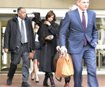 Former Baltimore mayor Catherine Pugh, center, leaves U.S. District Court in Baltimore on Thursday, Nov. 21, 2019. An 11-count federal indictment accuses Pugh of arranging fraudulent sales of her