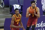 FILE - In this Thursday, Feb. 11, 2021 file photo, Southern California forward Evan Mobley (4) stands with his brother, forward Isaiah Mobley (3) during action against Washington in an NCAA college basketball game in Seattle. Evan Mobley has morphed into one of the best big men in college basketball for Southern California, back in the NCAA Tournament for the first time since 2017. The sixth-seeded Trojans (22-7) face the winner of a play-in game between No. 11 seed Drake and Wichita State on Saturday, March 20, 2021 in Indianapolis. (AP Photo/Ted S. Warren, File)