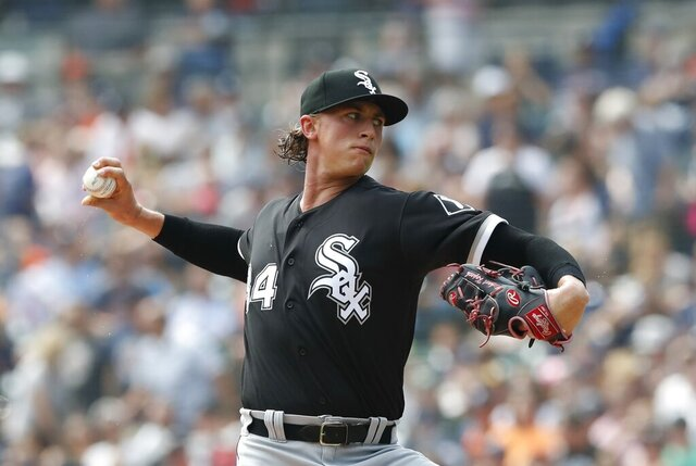 """FILE - In this Aug. 26, 2018, file photo, Chicago White Sox starting pitcher Michael Kopech throws during the first inning of a baseball game against the Detroit Tigers, in Detroit. White Sox prospect Michael Kopech missed the start of summer camp Frida, Ju;y 3, 2020, due to a personal matter. General manager Rick Hahn said he doesn't have a timeline for the return of the 24-year-old right-hander. """"Given the time we're living through together I will try to answer the question that's probably now at the top of everybody's mind and just share the fact that currently Michael is healthy,"""" Hahn said on a video conference call.(AP Photo/Carlos Osorio, File)"""