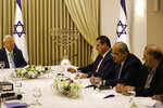 Israeli President Reuven Rivlin, left, listens to members of the Joint List Ayman Odeh, third right, Ahmad Tibi, second right, and Mansour Abbas, during a consultation meeting with in Jerusalem, Sunday, Sept. 22, 2019. Rivlin began two days of crucial talks Sunday with party leaders before selecting his candidate for prime minister, after a deadlocked repeat election was set to make forming any new government a daunting task. (Menahem Kahana/Pool via AP)