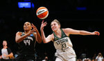 Seattle Storm forward Katie Lou Samuelson (33) knocks the ball out of the hands of New York Liberty guard/forward Betnijah Laney (44) during the second half of a WNBA basketball game Wednesday, Aug. 18, 2021, in New York. (AP Photo/Noah K. Murray)