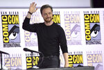 James McAvoy waves to the audience as he walks on stage at the