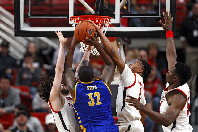 Texas Tech's Terrence Shannon Jr. (1) blocks Cal State Bakersfield's Shawn Stith (32) who shoots during the first half of an NCAA college basketball game Sunday, Dec. 29, 2019, in Lubbock, Texas. (AP Photo/Brad Tollefson)
