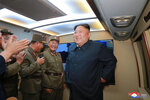 FILE - In this Tuesday, Aug. 6, 2019, file photo provided by the North Korean government, North Korean leader Kim Jong Un, right, visits an airfield in the western area of North Korea to watch its weapons demonstrations. North Korea on Friday, Aug. 9, 2019 said that its rubber-stamp parliament will hold its second meeting of the year on Aug. 29. It follows weeks of intensified North Korean weapons tests and belligerent statements over U.S.-South Korea military exercises and the slow pace of nuclear negotiations with the United States. Independent journalists were not given access to cover the event depicted in this image distributed by the North Korean government. The content of this image is as provided and cannot be independently verified. Korean language watermark on image as provided by source reads:
