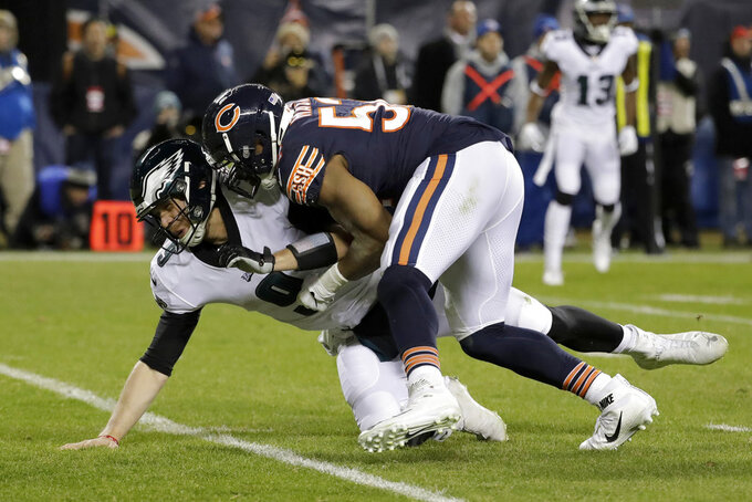 Chicago Bears outside linebacker Khalil Mack (52) tackles Philadelphia Eagles quarterback Nick Foles (9) during the second half of an NFL wild-card playoff football game Sunday, Jan. 6, 2019, in Chicago. (AP Photo/Nam Y. Huh)