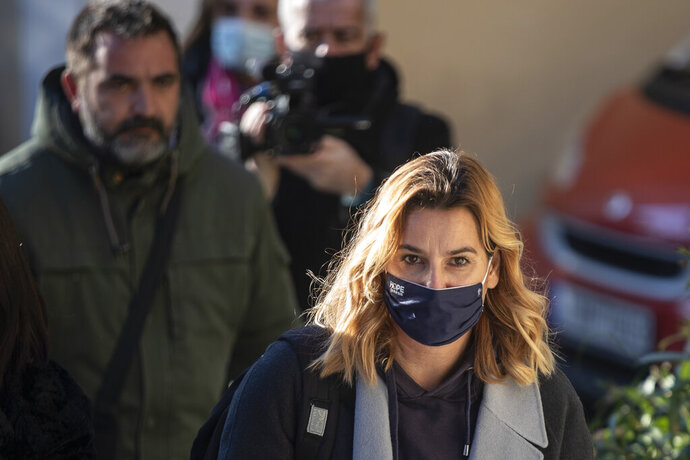 """Olympic sailing champion Sofia Bekatorou arrives at the prosecutor's office in Athens, on Wednesday, Jan 20, 2021. Bekatorou, who won gold at the 2004 Athens Olympics, last week said the male official from the Hellenic Sailing Federation performed a """"lewd act"""" after inviting her to his hotel room to discuss team preparations in 1998. Multiple claims by other female athletes of sexual misconduct from sporting administrators followed over the weekend. (AP Photo/Petros Giannakouris)"""