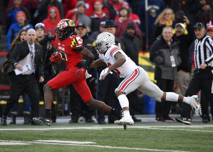 Maryland wide receiver Darryl Jones (21) runs with the ball against Ohio State cornerback Damon Arnette (3) during the second half of an NCAA football game, Saturday, Nov. 17, 2018, in College Park, Md. Ohio State won 52-51 in overtime. (AP Photo/Nick Wass)