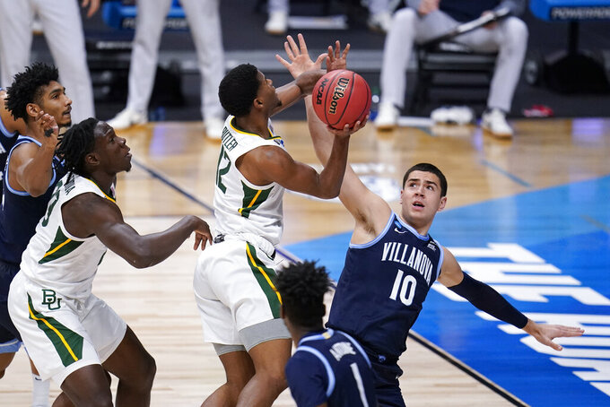Baylor guard Jared Butler (12) shoots on Villanova forward Cole Swider (10) in the first half of a Sweet 16 game in the NCAA men's college basketball tournament at Hinkle Fieldhouse in Indianapolis, Saturday, March 27, 2021. (AP Photo/Mike Conroy)
