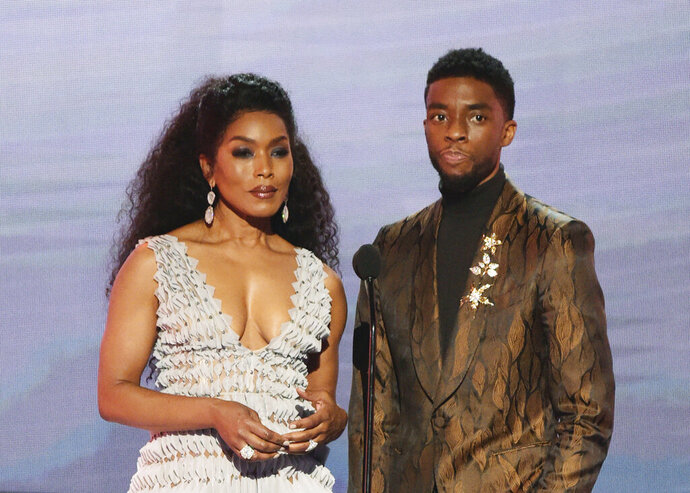 FILE - In this Jan. 27, 2019, file photo, Angela Bassett, left, and Chadwick Boseman, nominated for outstanding performance by a cast in a motion picture, introduce a clip from their film
