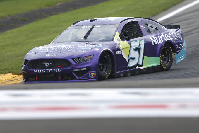 James Davison drives through Turn 1 during a NASCAR Cup Series auto race in Watkins Glen, N.Y., on Sunday, Aug. 8, 2021. (AP Photo/Joshua Bessex)