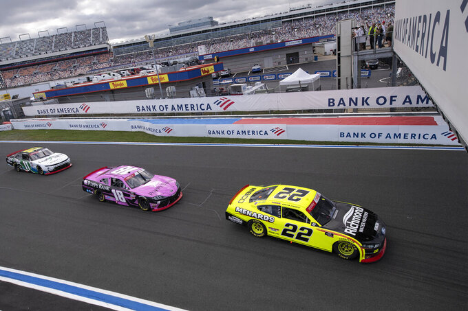 NASCAR Xfinity Series driver Austin Cindric (22) leads the field during the NASCAR Xfinity auto racing race at the Charlotte Motor Speedway Saturday, Oct. 9, 2021, in Concord, N.C. (AP Photo/Matt Kelley)