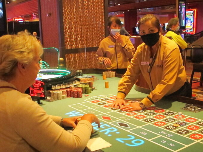 A dealer conducts a game of roulette at Bally's casino in Atlantic City N.J., in this June 23, 2021, file photo. Eight of Atlantic City's nine casinos posted an operating profit in the second quarter of this year as business improved and gamblers were eager to return to gambling halls in person. Figures released Monday, Aug. 23, 2021, by the New Jersey Division of Gaming Enforcement show the casinos collectively posted a gross operating profit of $185.1 million in April, May and June of this year.  (AP Photo/Wayne Parry)