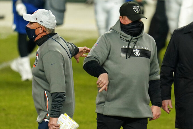 Denver Broncos head coach Vic Fangio, left, and Las Vegas Raiders head coach Jon Gruden greet each other after an NFL football game, Sunday, Jan. 3, 2021, in Denver. (AP Photo/Jack Dempsey)
