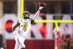 Idaho wide receiver Mekhi Stevenson (4) attempts to complete a pass reception during the first half of an NCAA college football game against Indiana, Saturday, Sept. 11, 2021, in Bloomington, Ind. (AP Photo/Doug McSchooler)