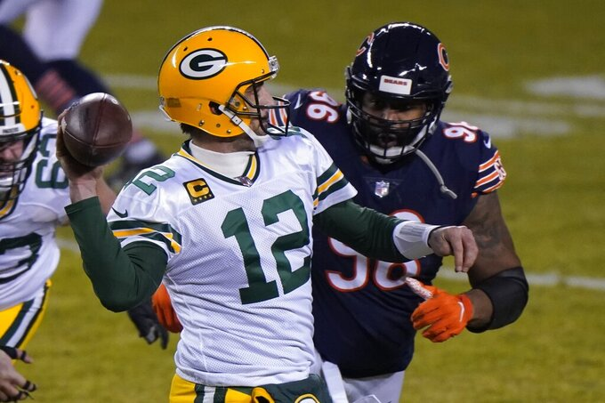 Green Bay Packers' Aaron Rodgers throws a pass during the second half of an NFL football game against the Chicago Bears Sunday, Jan. 3, 2021, in Chicago. (AP Photo/Nam Y. Huh)