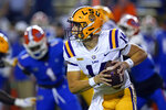 FILE - In this Dec. 12, 2020, file photo, LSU quarterback Max Johnson (14) scrambles during the first half of the team's NCAA college football game against Florida in Gainesville, Fla. While there are benefits to knowing now that Johnson will be LSU's starting quarterback, the Tigers also could profit from what looked to be a close competition for the position before Myles Brennan's fluke, off-the-field injury, coach Ed Orgeron said. (AP Photo/John Raoux, File)