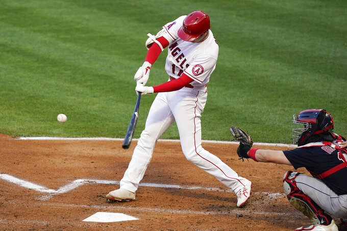 Los Angeles Angels designated hitter Shohei Ohtani (17) hits a home run during the first inning of a baseball game against the Cleveland Indians Tuesday, May 18, 2021, in Anaheim, Calif. (AP Photo/Ashley Landis)