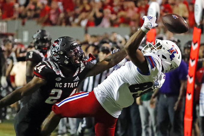 North Carolina State's Derrek Pitts Jr. (24) breaks up a pass intended for Louisiana Tech's Tahj Magee (89) during the first half of an NCAA college football game in Raleigh, N.C., Saturday, Oct. 2, 2021. (AP Photo/Karl B DeBlaker)