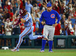 Philadelphia Phillies' Bryce Harper, left, rounds the bases for his grand slam as he passes Chicago Cubs first baseman Anthony Rizzo during the ninth inning of a baseball game Thursday, Aug. 15, 2019, in Philadelphia. The Phillies won 7-5. (AP Photo/Chris Szagola)