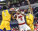 Mississippi guard Blake Hinson (0) is fouled by Cal State Bakersfield guard Czar Perry (5) as forward Greg Lee (21) also defends during an NCAA college basketball game, Saturday, Dec, 7, 2019, in Oxford, Miss. (Bruce Newman/The Oxford Eagle via AP)