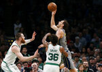 Indiana Pacers' Bojan Bogdanovic goes for a shot over Boston Celtics' Marcus Smart during the second quarter of an NBA basketball game Friday, March 29, 2019, in Boston. (AP Photo/Winslow Townson)