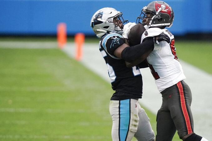 Carolina Panthers cornerback Troy Pride (25) and Tampa Bay Buccaneers wide receiver Antonio Brown (81) vie for the ball during the second half of an NFL football game, Sunday, Nov. 15, 2020, in Charlotte , N.C. (AP Photo/Gerry Broome)