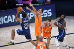 Dallas Mavericks' Josh Reaves (23) shoots over Phoenix Suns' Elie Okobo (2) during the second half of an NBA basketball game Thursday, Aug. 13, 2020 in Lake Buena Vista, Fla. (AP Photo/Ashley Landis, Pool)