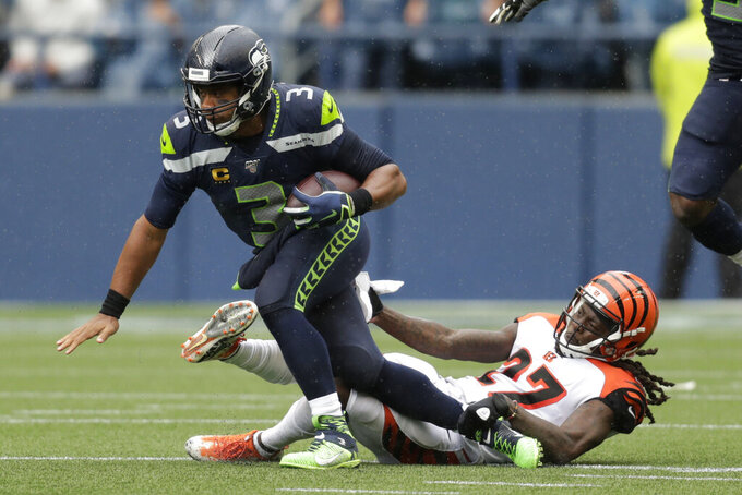 Seattle Seahawks quarterback Russell Wilson is sacked by Cincinnati Bengals cornerback Dre Kirkpatrick, right, during the second half of an NFL football game Sunday, Sept. 8, 2019, in Seattle. (AP Photo/Stephen Brashear)