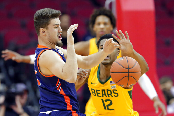 Tennessee-Martin guard Eman Sertovic, left, loses the ball as it's knocked away by Baylor guard Jared Butler (12) during the first half of an NCAA college basketball game Wednesday, Dec. 18, 2019, in Houston. (AP Photo/Michael Wyke)