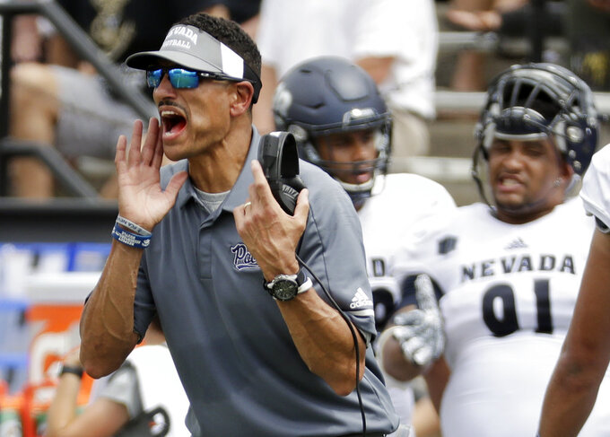 Nevada head coach Jay Norvell yells to his players in the first half of an NCAA college football game against Vanderbilt, Saturday, Sept. 8, 2018, in Nashville, Tenn. (AP Photo/Mark Humphrey)