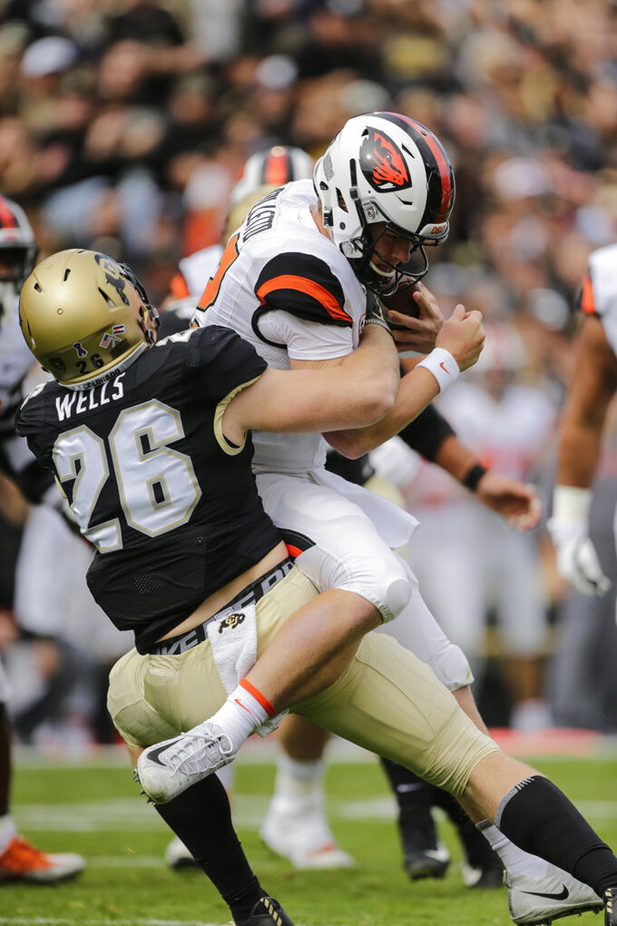 Colorado linebacker Carson Wells (26) sacks Oregon State quarterback Jack Colletto (12) during the first half of an NCAA college football game, Saturday, Oct. 27, 2018, in Boulder, Colo. (AP Photo/Jack Dempsey)