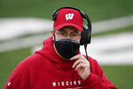 Wisconsin head coach Paul Chryst stands on the sideline during the first half of an NCAA college football game against Iowa, Saturday, Dec. 12, 2020, in Iowa City, Iowa. (AP Photo/Charlie Neibergall)