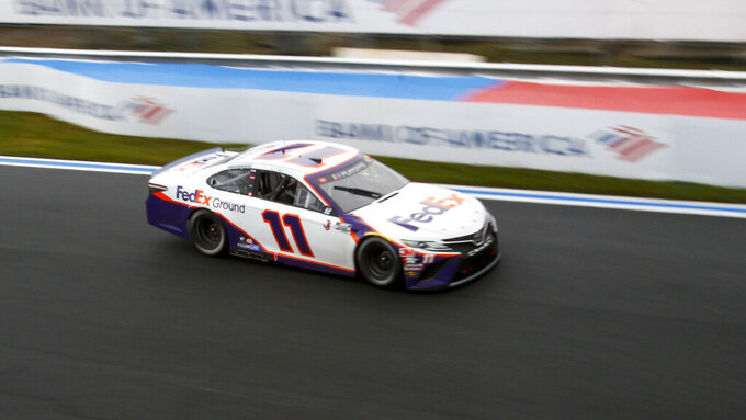 Denny Hamlin (11) competes in a NASCAR Cup Series auto race at Charlotte Motor Speedway in Concord, N.C., Sunday, Oct. 11, 2020. (AP Photo/Nell Redmond)