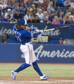 Toronto Blue Jays' Bo Bichette hits a two-run home run against the New York Yankees during the fifth inning of a baseball game Thursday, Aug. 8, 2019, in Toronto. (Fred Thornhill/The Canadian Press via AP)