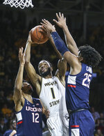 Wichita State forward Markis McDuffie is defended by Connecticut forwards Josh Carlton, left, and Tyler Polley during the first half of an NCAA college basketball game in Wichita, Kan., Thursday, Feb. 28, 2019. (Travis Heying/The Wichita Eagle via AP)