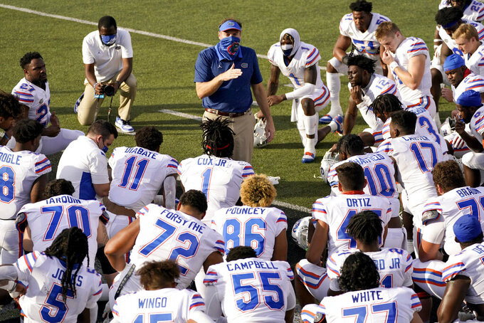 Florida head coach Dan Mullen speaks to his his players after an NCAA college football game against Vanderbilt Saturday, Nov. 21, 2020, in Nashville, Tenn. Florida won 38-17. (AP Photo/Mark Humphrey)